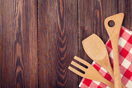 kitchen table top: Kitchen cooking utensils over wooden table background. Top view with copy space. Retro toned