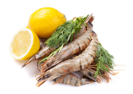 Fresh raw tiger prawns and spices. Isolated on white background