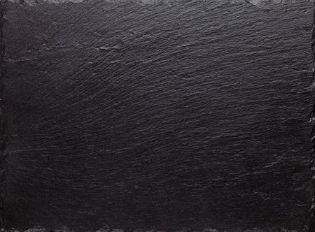 Black slate stone texture background Foto de archivo