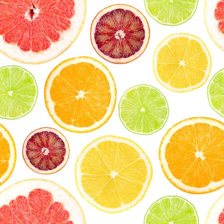 Citrus seamless background. Grapefruit, orange, lemon and lime. Isolated on white photo