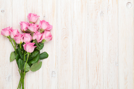 pink wedding: Pink roses bouquet over wooden table. Top view with copy space