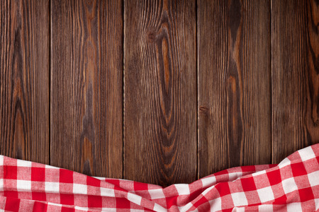 background wood: Kitchen table with red towel. Top view with copy space