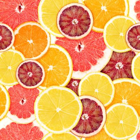 Citrus seamless background. Grapefruit, orange and lemon photo