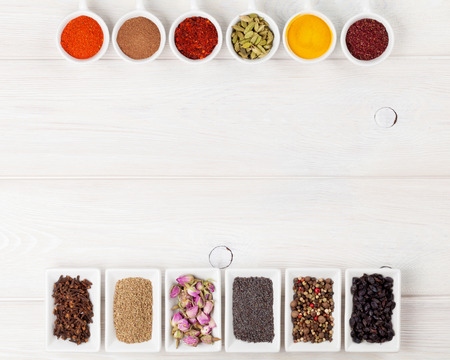 indian food: Various spices on white wooden background. Top view with copy space