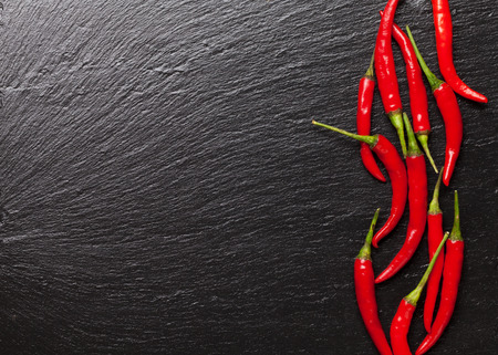 Red chili peppers on black stone. Top view with copy space Stok Fotoğraf - 39907014