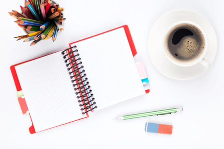 background calendar: Office desk table with supplies and coffee cup on white background
