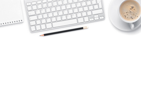 Office desk table with computer, supplies and coffee cup. Isolated on white background Standard-Bild