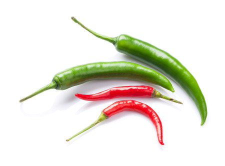 capsaicin: Green and red chili peppers. Isolated on white background Stock Photo