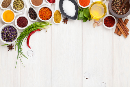 Various spices on white wooden background. Top view with copy space