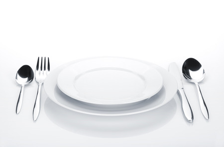 flatware: Silverware or flatware set and plates. Isolated on white background