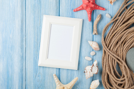 star fish: Summer time sea vacation with blank photo frame, star fish and marine rope