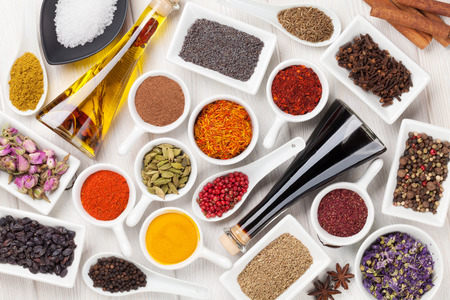 cooking ingredients: Various spices on white wooden background. Top view