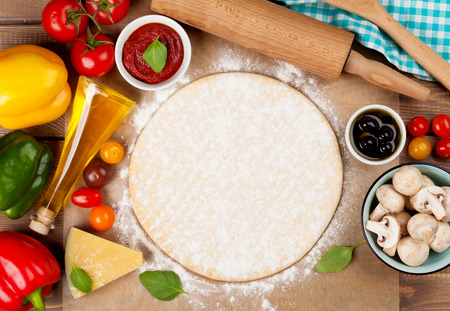 Pizza cooking ingredients. Dough, vegetables and spices. Top view with copy space Banco de Imagens - 40196728