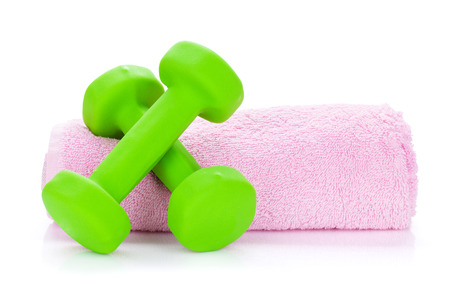 Two green dumbbells and towel. Isolated on white background