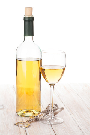 white wine bottle: White wine glass, bottle and corkscrew on white wooden table Stock Photo