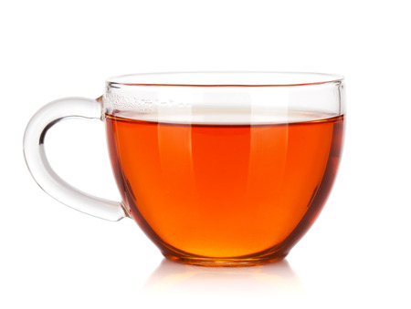 Glass cup of black tea. Isolated on white background Фото со стока