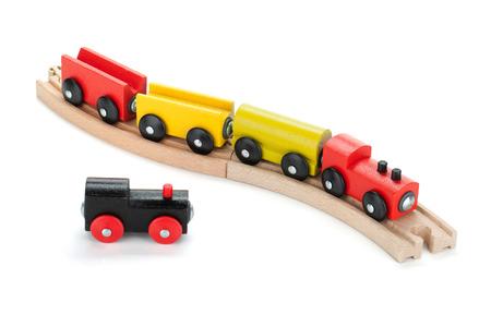 juguetes de madera: Trenes de juguete de madera. Aislado en el fondo blanco Foto de archivo