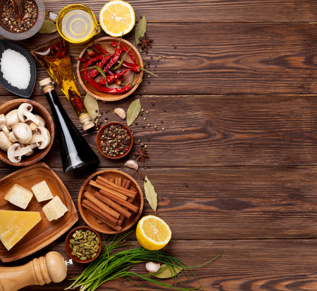 Various spices on wooden background. Top view with copy space photo