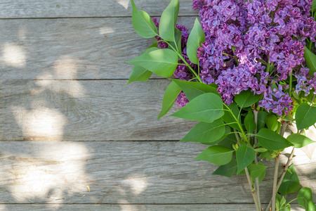 copyspace: Colorful lilac flowers on garden table. Top view with copy space