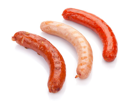 Various grilled sausages. Isolated on white background 免版税图像