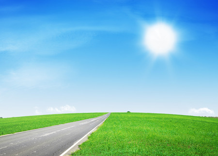 blue green landscape: Summer landscape with asphalt road through the green field and blue sky Stock Photo