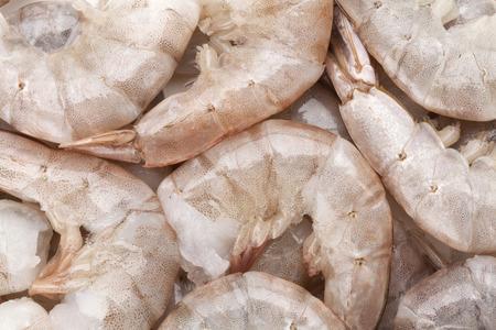 Raw uncooked shrimps Closeup background