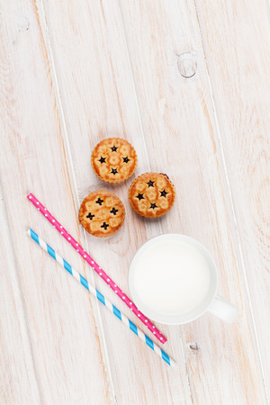 milk and cookies: Cup of milk, cookies and drinking straws. Top view with copy space