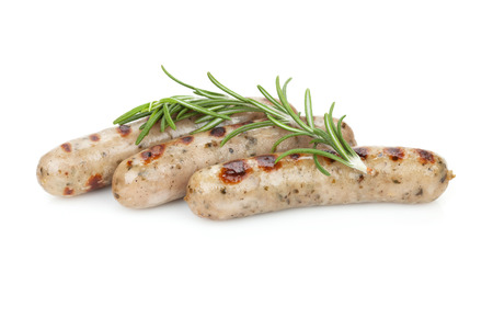 Grilled sausages with rosemary. Isolated on white background Imagens