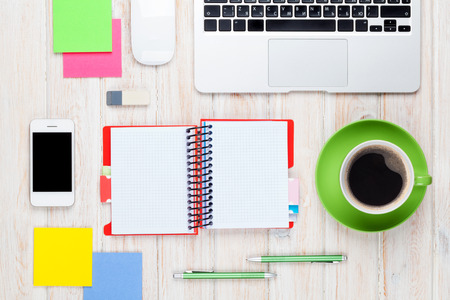 Office desk table with computer, supplies and coffee cup. Top view with copy space 스톡 콘텐츠