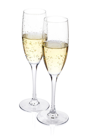 drinking glasses: Two champagne glasses. Isolated on white background Stock Photo
