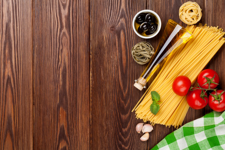 Italian food cooking ingredients. Pasta, vegetables, spices. Top view with copy space photo