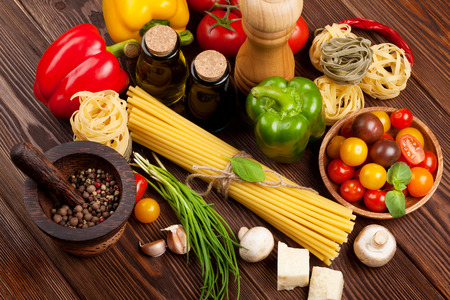 Italian food cooking ingredients. Pasta, vegetables, spices. Top view 免版税图像