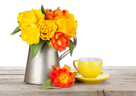 tulip: Colorful tulips bouquet in watering can and coffee cup on wooden table. Isolated on white background