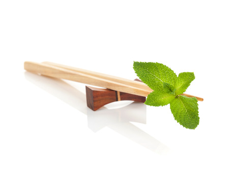 chop stick: Sushi chopsticks with mint leaves. Isolated on white background