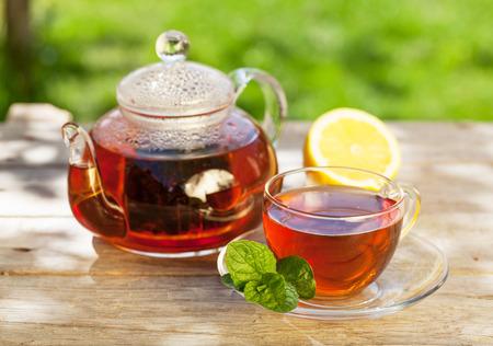 breakfast garden: Breakfast tea on table in sunny garden Stock Photo