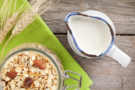 Healthy breakfast with muesli and milk On wooden table Stock Photo - 41539544