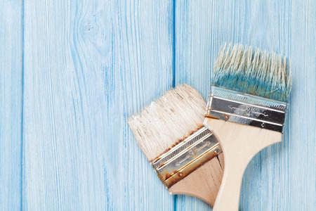 floor texture: Paintbrush over blue wood. Top view with copy space