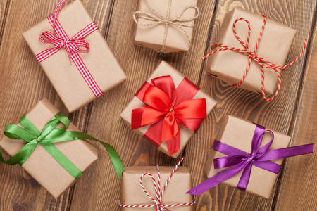 Gift boxes on wooden table background with copy space Imagens