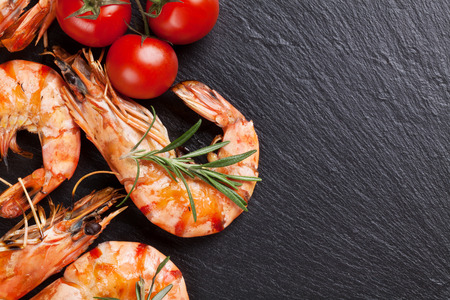 prawn: Grilled shrimps on stone plate. Top view with copy space