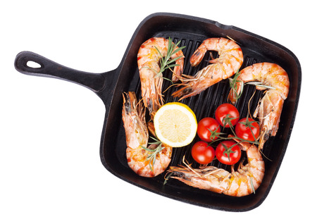 tiger shrimp: Grilled shrimps on frying pan. Isolated on white background Stock Photo