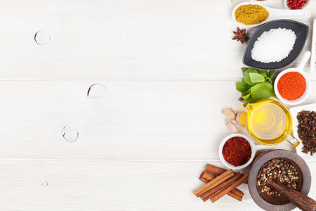 Various spices on white wooden background. Top view with copy space Banco de Imagens - 41539113