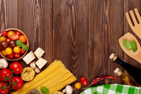 copy space: Italian food cooking ingredients. Pasta, vegetables, spices. Top view with copy space