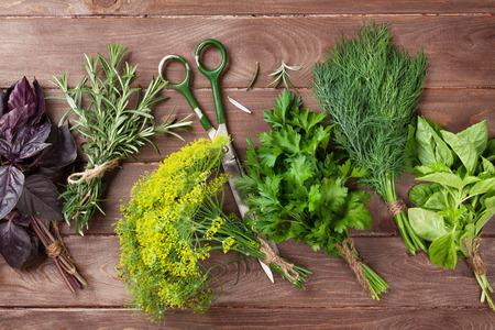 Fresh garden herbs over wooden table. Top view Archivio Fotografico