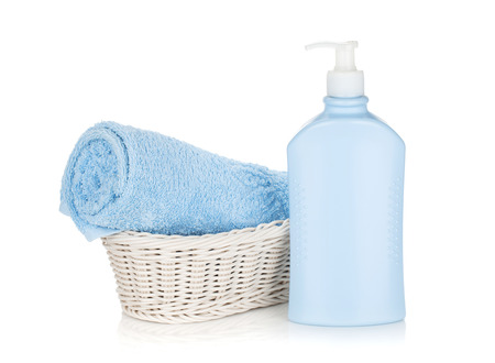 aroma facial: Shampoo bottle and blue towel. Isolated on white background Stock Photo
