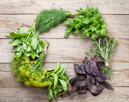 wooden table: Fresh garden herbs on wooden table. Top view with copy space