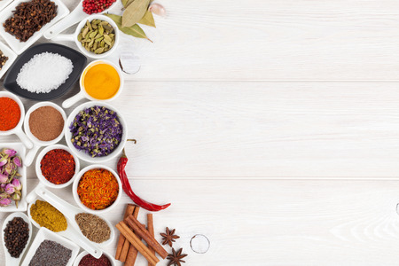 indian spices: Various spices on white wooden background. Top view with copy space