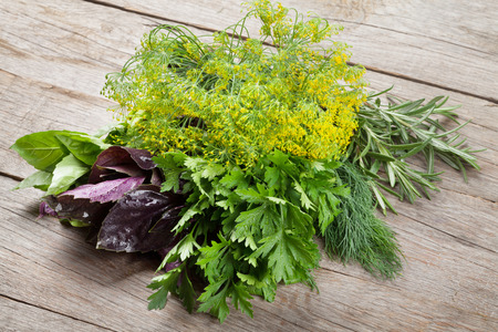 Fresh garden herbs on wooden table. Top view Stock Photo