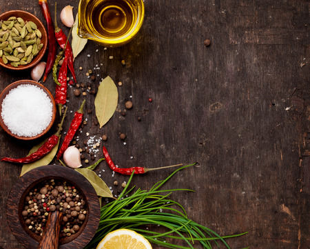 wood table: Various spices on wooden background. Top view with copy space
