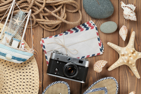 travel destinations: Travel and vacation items on wooden table. Top view