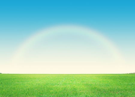 rainbow scene: Green grass field and deep blue sky with rainbow background